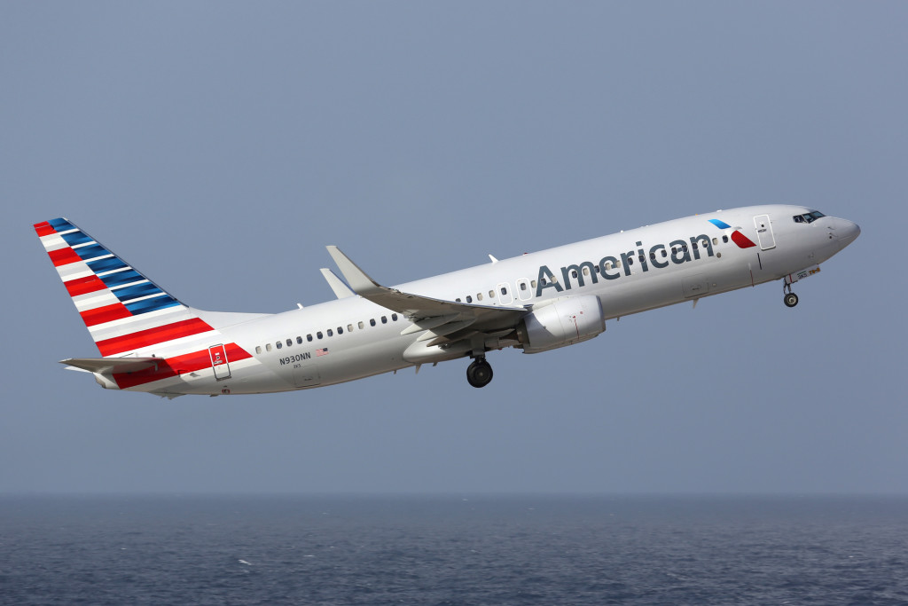 Curacao - February 16, 2014: An American Airlines Boeing 737-800 with the registration N930NN taking off from Curacao Airport. American Airlines is the world's largest airline with 619 aircraft and 108 million passengers. It is headquartered in Fort Worth, Texas.