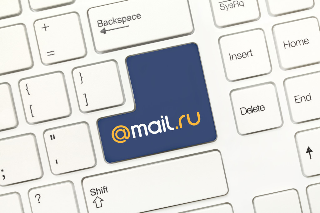 Close-up view on white conceptual keyboard - Mail.ru (key with logotype)
