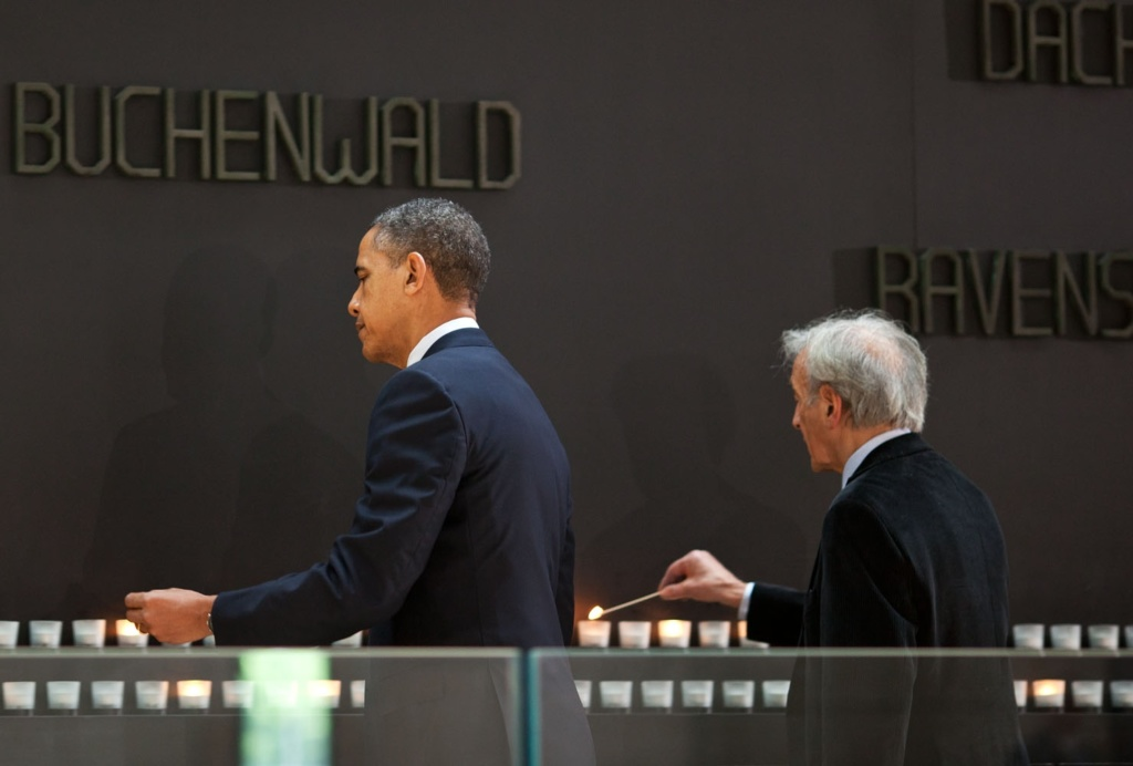 President Barack Obama, with Elie Wiesel, Nobel Peace Prize laureate and Holocaust survivor, lights a candle at the Buchenwald Memorial during a tour of the United States Holocaust Memorial Museum in Washington, D.C., April 23, 2012. (Official White House Photo by Pete Souza)