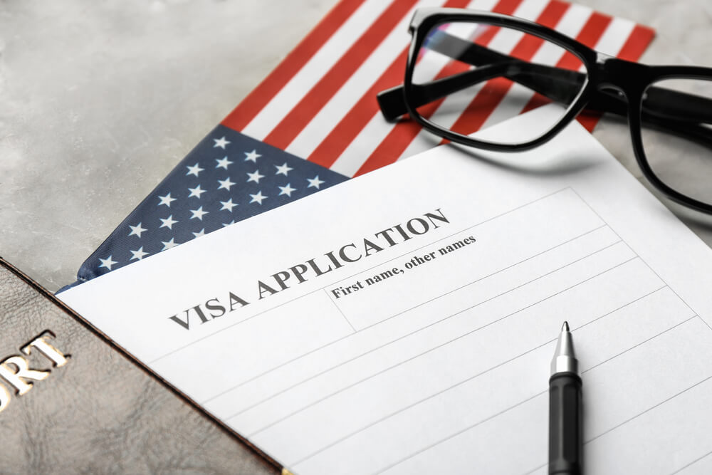 What should immigrants do who have no money to pay USCIS fees